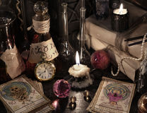 Close up of the tarot cards, magic books and candles Royalty Free Stock Images