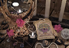 Close up with the tarot cards, mirror and black candle Royalty Free Stock Images
