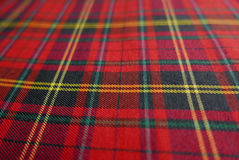 Close up of Tartan textile pattern. Close up of Tartan textile pattern consisting of criss-crossed horizontal and vertical bands in multiple colours Royalty Free Stock Image