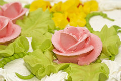 Close-up of tasty cake with cream, pink roses Stock Photo