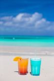 Close up tasty cocktails on the white sandy beach Stock Images