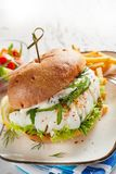 Close-up of fish burger served with French fries royalty free stock photo