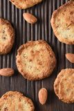 Close up of tasty homemade almond cookies and raw almonds on rib. Bed oak board overhead view Royalty Free Stock Images