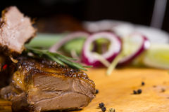 Close up Tasty Meat Dish on Wooden Board Royalty Free Stock Photography