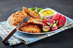 Close-up of tasty Parmesan breaded chicken breast royalty free stock images