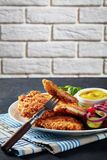 Close-up of tasty Parmesan breaded chicken breast stock photography