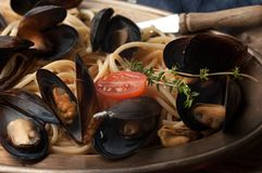Close up of tasty traditional italian pasta and mussels royalty free stock photography