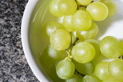 Close up of tasty whine grapes in white bowl Royalty Free Stock Photos