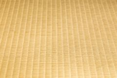 Close up of tatami, japanese traditional room floor matt, viewing in an angle to show texture on craftmanship and design. Selective focus stock photos