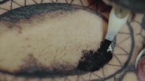 Close-up of tattoo machine tattooing a pattern on body macro. HD stock footage