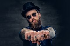 Close-up tattooed hipster`s fingers with rings. Close up tattooed hipster`s fingers with rings Royalty Free Stock Photo