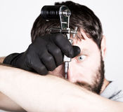 Close-up of Tattooist hands in black gloves with tattoo machine Royalty Free Stock Photo