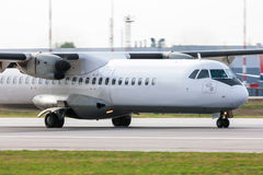 Close up of a taxiing aircraft. Close up of a taxiing turboprop aircraft royalty free stock images