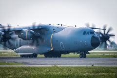 Close-up taxiing of heavy military transport turboprop aircraft. Close-up taxiing of heavy military transport turboprop airplane royalty free stock image