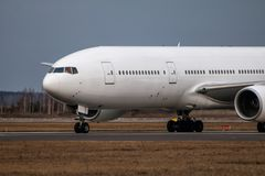 Close-up taxiing white wide body passenger airplane. Close-up taxiing white wide body passenger aircraft stock photo