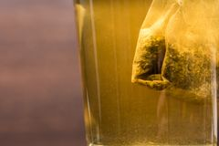 Teabag pulls in the tea glass royalty free stock photo