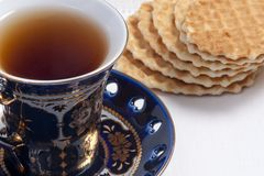 Close-up of  teacup and cookies Stock Images