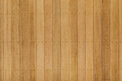 Teak wood panel with brass nail Royalty Free Stock Photography