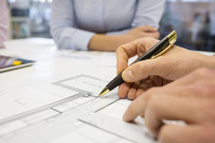Close-up of Team architects working on construction project in o Royalty Free Stock Photo