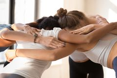 Group of women standing together embracing prepare for competiti royalty free stock images