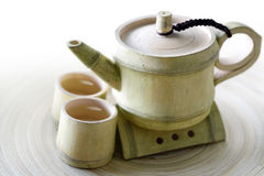 Close-up of Teapot. Tea in a antique cup and Teapot Royalty Free Stock Images