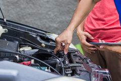Technician checking carburetor. Close up techinician hand opening carburetor  customer car Royalty Free Stock Image