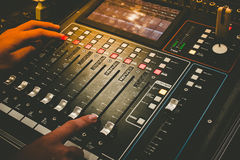 Close up of technical hand with music mixer equalizer console for mixer control sound device. Audio mixer equalizer control for background royalty free stock image