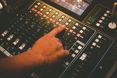 Close up of technical hand with music mixer equalizer console for mixer control sound device. Audio mixer equalizer control for background royalty free stock photo