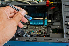 Close up of a technician's hands wiring computer parts Royalty Free Stock Photography