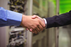 Close-up of technicians shaking hands Stock Image