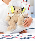 Close-up of a teddy bear with headphones on Stock Photos