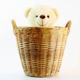 Teddy bear sitting in a wicker basket on white background. Close-up Teddy bear sitting in a wicker basket on white background royalty free stock photos
