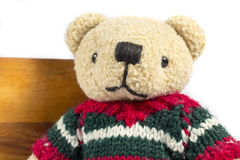 Close-up of teddy bear with wool coat Royalty Free Stock Photos