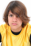Close Up of Teen Boy. In yellow shirt. Serious expression Stock Photography