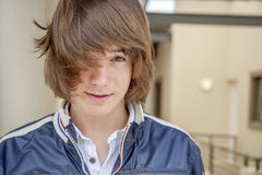 Close up of teen boy. With long hair Royalty Free Stock Image