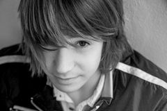 Close up of teen boy. With long hair Royalty Free Stock Photos
