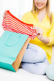 Close up of teen girl with shopping bag and shirt. Clothing, fashion, style and people concept - close up of happy young woman or teenage girl with shopping bag Stock Photography