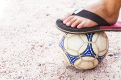 Close up of foot on top of soccer ball Royalty Free Stock Photography