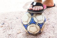 Close up of foot on top of soccer ball Royalty Free Stock Image