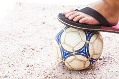 Close up of foot on top of soccer ball Royalty Free Stock Photos