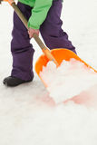 Close Up Of Teenage Boy Shovelling Snow From Path Stock Photo