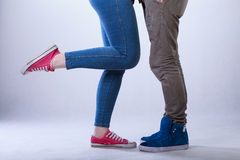 Close-up of teenage couple legs Stock Images