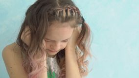 Close up of a teenage girl crying at home, covering her face with hands. Close up of a teenage girl crying at home, covering her face with hands stock video