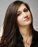 Close-up of teenage girl with dark long hair Stock Photo