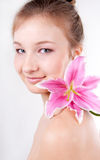 Close-up of  teenage girl with lily flower Royalty Free Stock Photography