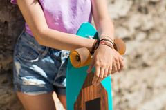 Close up of teenage girl with longboard. Lifestyle, leisure and people concept - close up of teenage girl or young woman with longboard Stock Photography