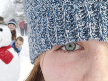 Close up of teenage girl wearing knit hat Stock Image