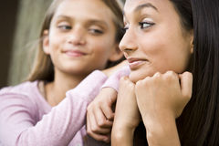 Close-up of teenage girl and younger sister Stock Photo