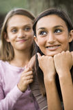 Close-up of teenage girl and younger sister Stock Photography
