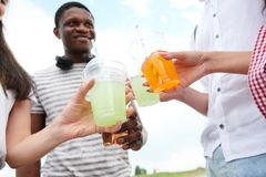 People drinking cocktails stock photo